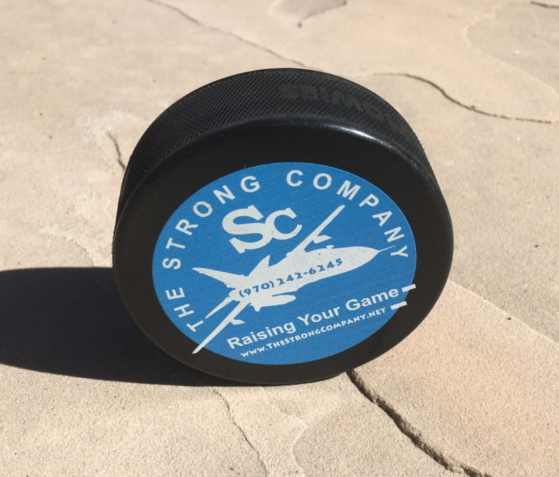 the-strong-company-hockey-puck